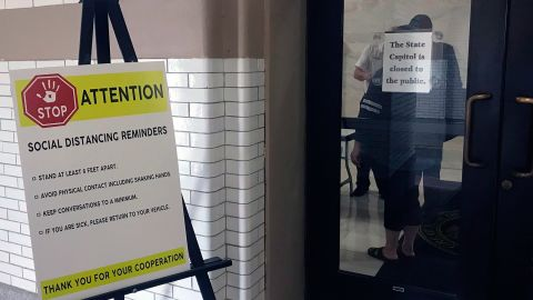 Signs outside the state Capitol in Little Rock, Arkansas, include reminders about social distancing.