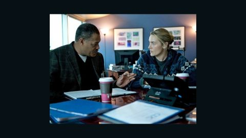 """Laurence Fishburn and Kate Winslet in a scene from the Warner Bros. movie """"Contagion."""""""