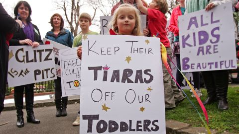 """A girl protests a child beauty pageant hosted by the U.S. company behind """"Toddlers and Tiaras"""" in Melbourne, Australia."""