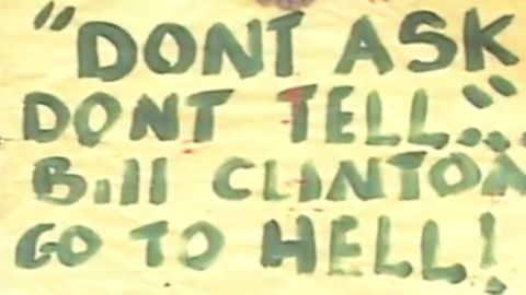 """A protester holds up a sign expressing anger at the passage of """"Don't Ask, Don't Tell"""""""