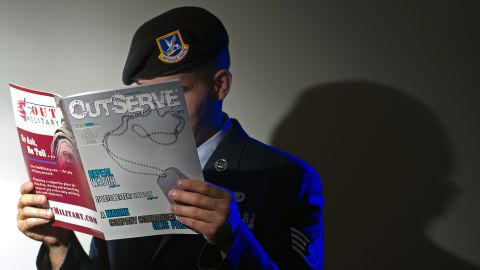 A member of the Air Force reads a copy of OutServe, a magazine for lesbian, gay, bisexual and transgender military personnel.