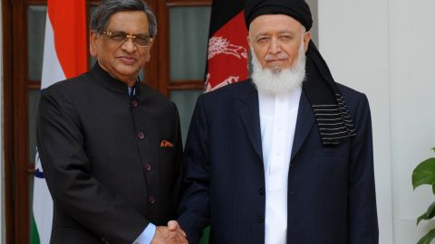 Indian Minister of External Affairs S.M. Krishna (L) shakes hands with Chairman High Peace Council of Afghanistan Burhanuddin Rabbani during a meeting in New Delhi on July 14, 2011. Rabbani is in India on a four-day visit. India has been a major donor to Afghanistan since the fall of the Taliban in 2001. AFP PHOTO/RAVEENDRAN (Photo credit should read RAVEENDRAN/AFP/Getty Images)