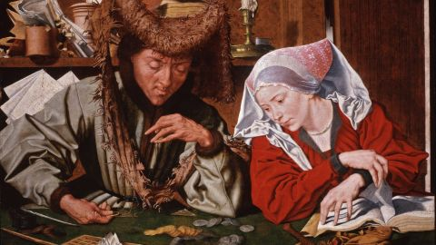 """""""The Money-changer and his Wife."""" This 1540 painting by Marinus van Reymerswaele took the increasingly common practice of money-changing as its subject."""