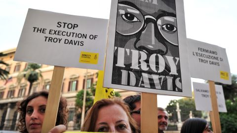 Amnesty International activists hold banners in support of Troy Davis at the U.S. Embassy in Rome on September 16.