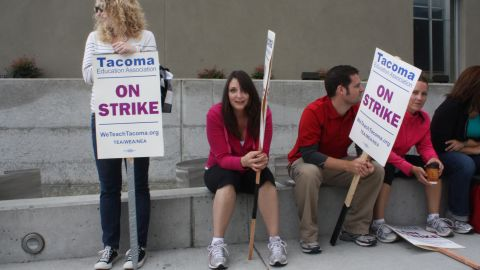 Teachers in Tacoma, Washington, hold picket signs outside a school last week.