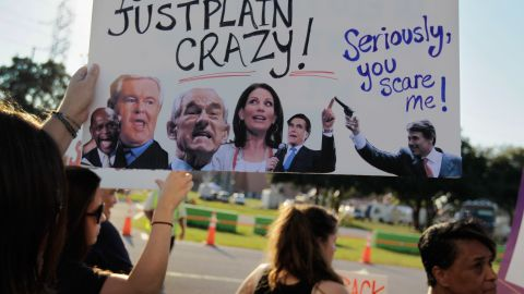 Protesters outside the  CNN/Tea Party Express GOP presidential debate September 12 in Tampa, Florida.