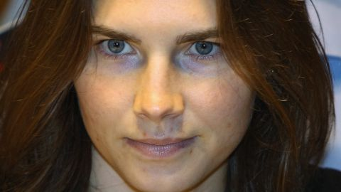 Amanda Knox is escorted to her appeal hearing at Perugia's Court of Appeal on September 29, 2011 in Perugia, Italy