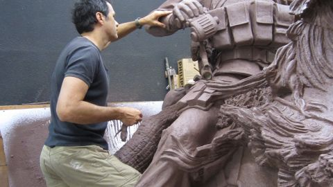 Artist Douwe Blumberg puts final touches on a clay sculpture that will honor U.S. special operations forces.