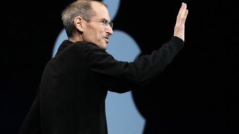 Apple CEO Steve Jobs waves as he delivers the keynote address.