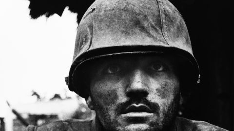 A U.S. Marine suffering from severe shell shock waits to be evacuated to safety during the Battle for Hue, Vietnam, 1968.