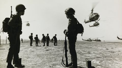 Don McCullin's first photograph of the Vietnam War: South Vietnamese soldiers wait for helicopter transport at a Landing Zone in the Mekong Delta, Vietnam.