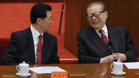 Former Chinese President Jiang Zemin, right, sits with President Hu Jintao at the ceremony on Sunday.