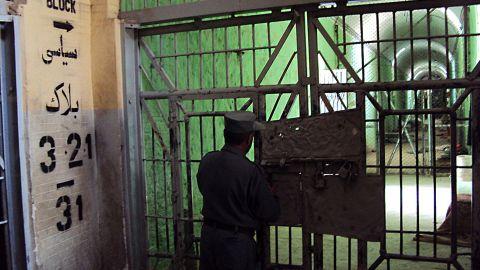 An Afghan policeman stands guard inside Kandahar jail on April 27, 2011