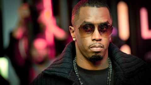 """Diddy signs copies of his single """"Coming Home"""" in London on January 20, 2011"""