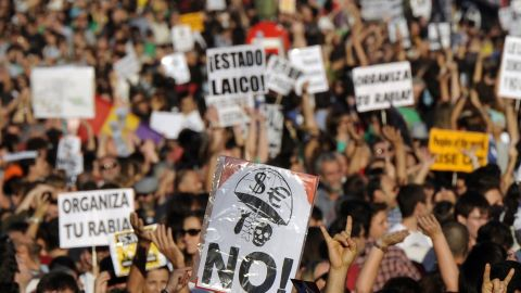 """More than 10,000 protesters retake the streets Saturday, in Madrid, where five months ago the """"May 15 Movement"""" began. Some demonstrators said they felt Spain's protest had gone global and that the world had joined their movement."""