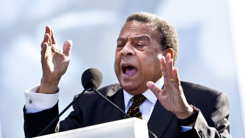 """Former U.N. ambassador, former Atlanta mayor and civil rights leader Andrew Young speaks during the dedication.  Young said King was sensitive about his small stature, as he stood only 5 feet 7 inches. """"Now he's 30 feet tall, looking down on everybody,"""" Young said."""