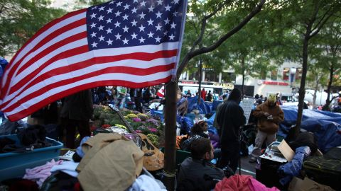 Occupy Wall Street protesters remain in New York's Zuccotti Park on Monday, 31 days after the movement began.