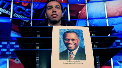 University of Nevada student Peter Galvan stands in for Herman Cain during Tuesday's debate rehearsal.