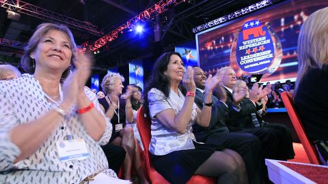 The audience claps as CNN's Anderson Cooper introduces the candidates.
