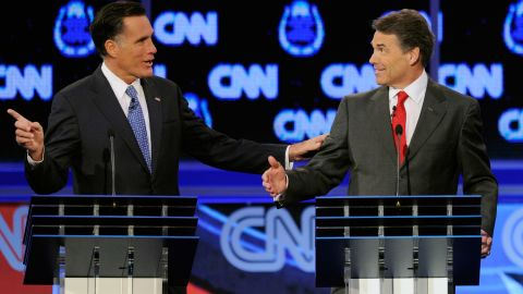 Former Massachusetts Gov. Mitt Romney, left, and Texas Gov. Rick Perry clash over the topic of immigration during the presidential debate on Tuesday, October 18, in Las Vegas. Romney criticized Perry for interrupting him.