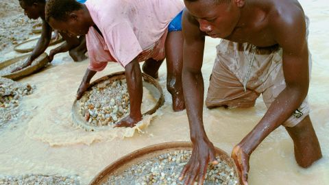Workers pan for diamonds in a mine near Kenema, Sierra Leone, in June 2001. Diamonds were the main issue in the west African country's decade-long tumultuous civil war.