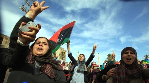 Libyans wave their new national flag as they celebrate in Tripoli. Interim Prime Minister Mahmoud Jibril told reporters Thursday that Gadhafi had been killed.
