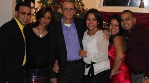 """Franklin """"Gomito"""" and Rosanna Gomez, center, with their family."""