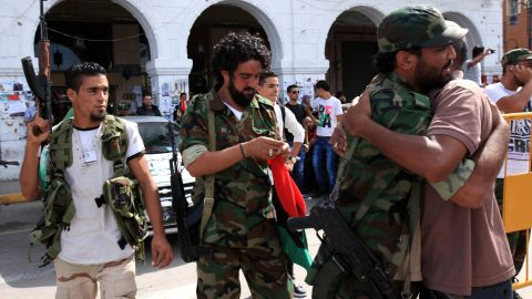 Libyan NTC fighters are congratulated Thursday during celebrations in the streets of Tripoli after news of Moammar Gadhafi's capture.