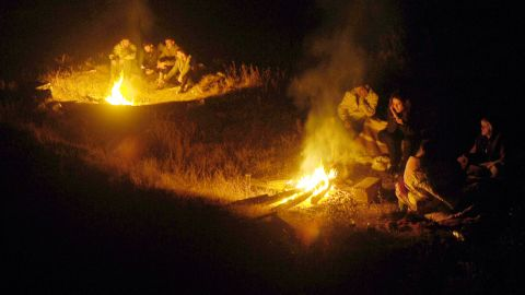 Residents of Ercis, Turkey, gather around fires in the aftermath of a the quake that rocked the city on Sunday.