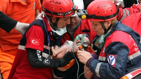 Rescue workers carry 2-week-old baby Azra Karaduman. The baby was pulled from debris on Tuesday, October 25, in Ercis, Turkey, two days after a deadly earthquake devastated parts of eastern Turkey.
