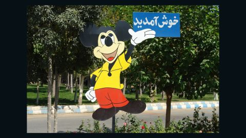 Mickey Mouse welcomes visitors to Tehran's Eram Park.