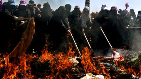 Yemeni veiled women burn veils in a symbolic and traditional move in Sanaa on October 26, 2011 to protest the regime's crackdown on female protesters.