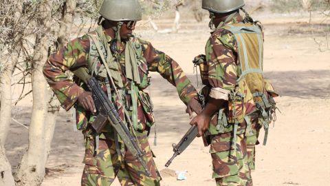 Kenyan soldiers prepare to advance near Liboi in Somalia, on October 18, 2011, near Kenya's border town with Somalia