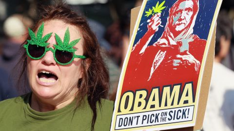 Medical marijuana advocate The Holy Hemptress protests outside of the hotel where President Obama was staying on Tuesday.