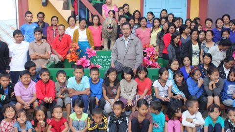 Ziona, center, with his has 39 wives, 86 children and 35 grandchildren in rural Baktwang village, India.