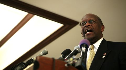 Herman Cain talks at an event in Alexandria, Virginia, Tuesday, and then left without answering reporters' questions about sexual harassment accusations that have surfaced from the time when he was the head of the National Restaurant Association. (Photo by Alex Wong/Getty Images)