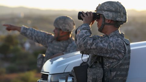 U.S. Army National Guardsmen scan the US-Mexico border in June 2011 in Nogales, Arizona.