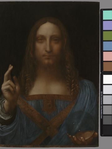"""The restoration work to the """"Salvator Mundi"""" involed cleaning off layers of varnish and over-paint, repairing a crack in the wood panel and re-touching damaged areas of the painting."""