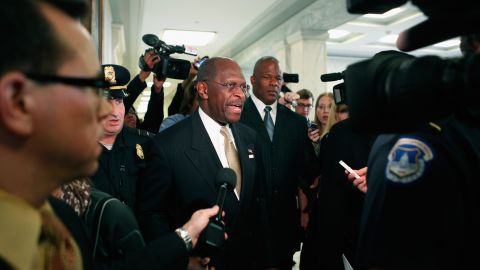 GOP presidential candidate Herman Cain attracts a crowd Wednesday on a visit to Capitol Hill.