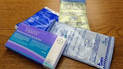 Approved in 1960 by the Food and Drug Administration, oral contraceptives involve taking a daily pill with a combination of estrogen and a progestin. The hormones prevent ovulation and thicken a woman's cervical mucus, blocking sperm from fertilizing an egg.