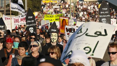 """Thousands of protesters march to the Port of Oakland for a general strike Wednesday. Port officials said Thursday that  """"the situation remains fluid"""" after the earlier shutdown."""