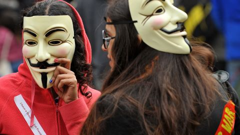 Protesters wearing Guy Fawkes masks gather outside St. Paul's Cathedral in London on October 16.