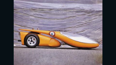 Life-sized model of a two-part hybrid car, 1970. The engine and cam shaft are taken from a Lamborghini Miura. The separate passenger cabin is designed like the cockpit of a glider.