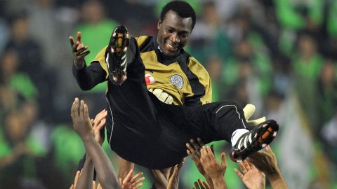 Al Sadd goalkeeper Mohamed Saqr is lifted by his teammates after the penalty shootout win over Jeonbuk on Saturday.