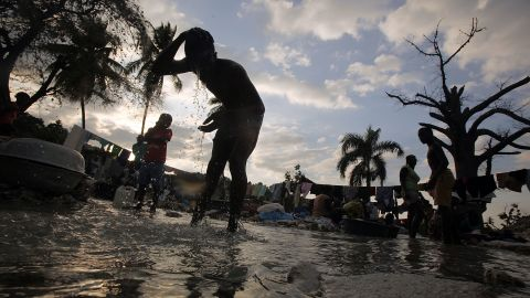 Haitians wash clothes in a stream in Port-au-Prince. The widespread user of rivers has been liked to the country's deadly cholera outbreak.