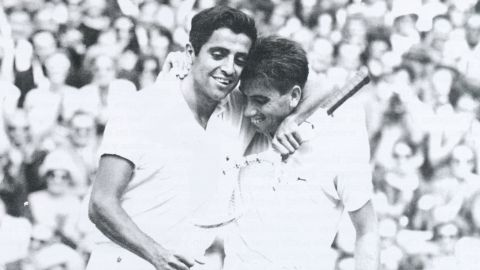 Rafael Osuna congratulates 1966 Wimbledon winner Manuel Santana of Spain after losing to him at the All England Club.