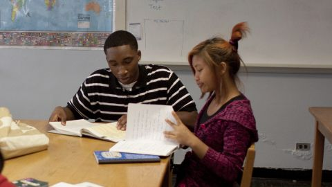 Zai, right, works with her tutor, Joshua Randolph, a volunteer from Georgia Perimeter College.