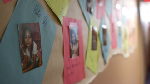 Photos of the students line the hallway of Global Village.