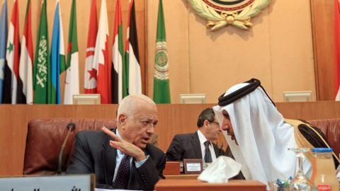Qatari Prime Minister Sheikh Hamad bin Jassim, right, speaks to Arab League Secretary General Nabil al-Arabi on Saturday.