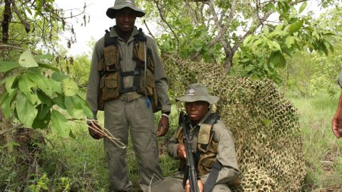 The South African military and heavily-armed private security forces patrol Kruger National Park looking for poachers.